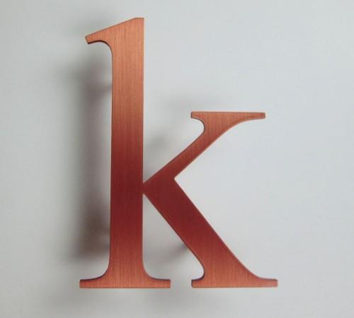 copper-letter-brushed-k-times-rom