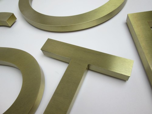 Built up brass letters with a brushed finish.